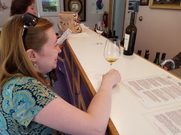 Liz in front of it, tasting the orange Marsanne.